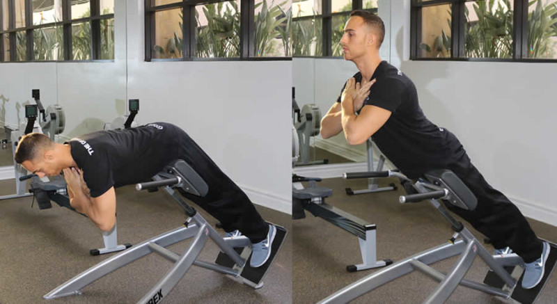 Hyperextensions Performed by Male Personal Trainer