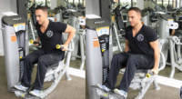 Machine Tricep Press Performed by Male Personal Trainer