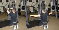 Two Arm High Reverse Cable Fly Performed by Male Personal Trainer