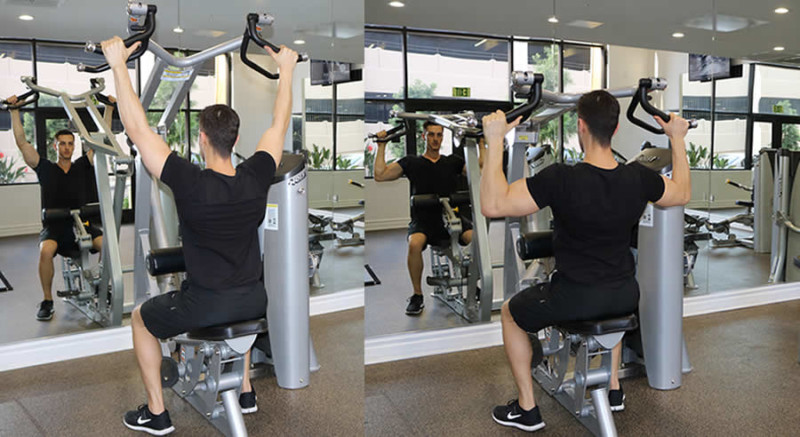 machine lat pulldown performed by male personal trainer