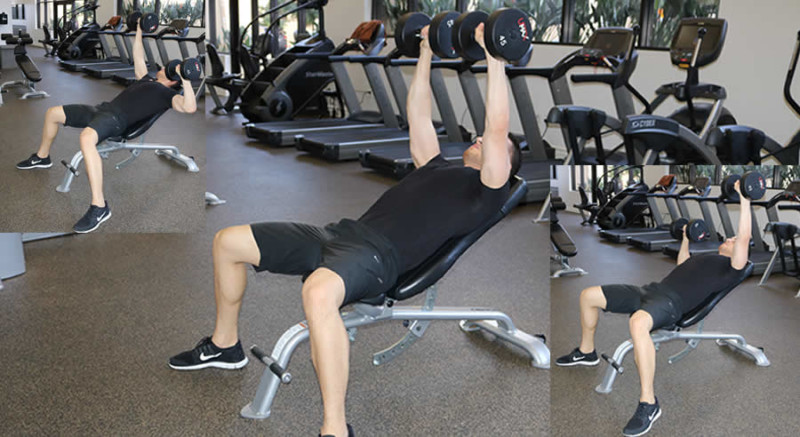 incline dumbbell press with isometric hold performed by male personal trainer